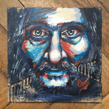 portrait d'un homme barbu dans les tons bleu et rouge