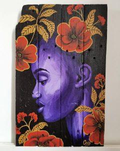 Peinture sur bois de Coraline Van Butsele, portrait de femme africaine dans un esprit wax